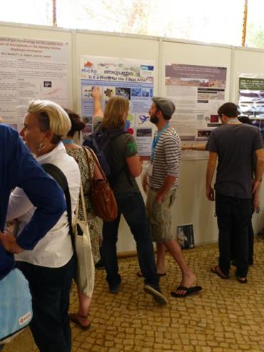 PRIMO attendees discuss poster presentation